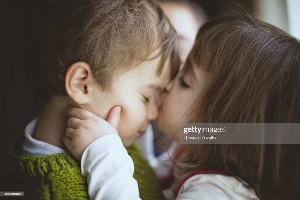 Small Girl Kissing A Boy Stock Photo Getty Images