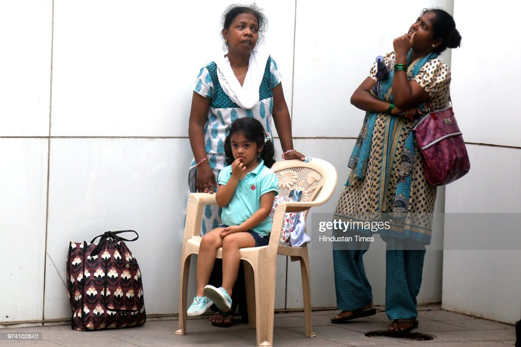 A small girl looks tensed as major fire broke out at BeauMonde Towers at Prabhadevi, on June 13, 2018 in Mumbai, India. Two firemen had to be hospitalised after a major blaze charred the top three floors of a 33-storey residential high rise. No other casualties were reported at the BeauMonde Towers, where Bollywood actor Deepika Padukone also owns a 26th floor apartment. As many as 95 people were safely evacuated from the building soon after the fire alarm went off.