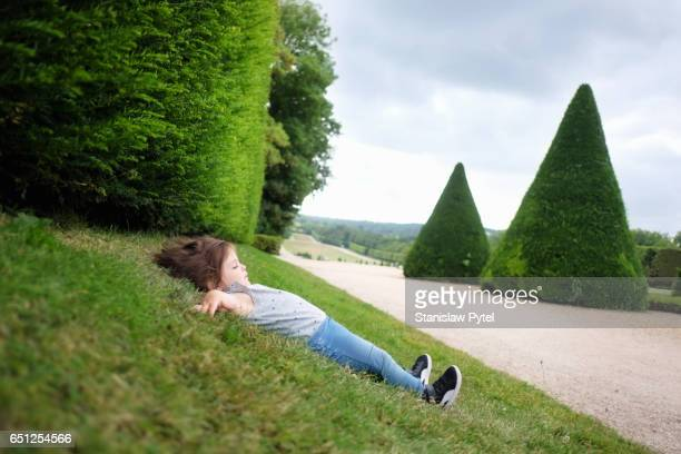 Small girl lying on grass
