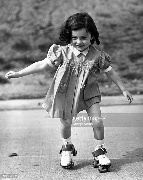 Small girl on roller skates