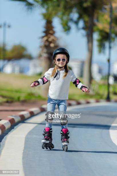 small girl on rollerskate - inline skate stock photos and pictures
