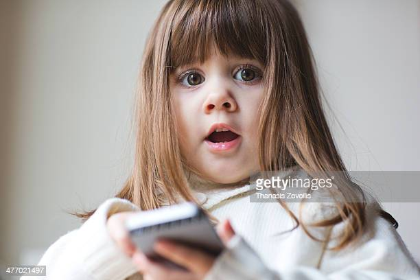 Small girl playing with a smartphone
