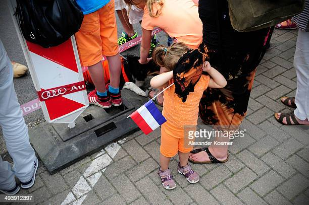 A small girl plays hideandseek under the skirt of her Mum while she waits for King WillemAlexander of the Netherlands and Queen Maxima at the AUDI...