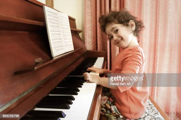 Small girl plays the piano