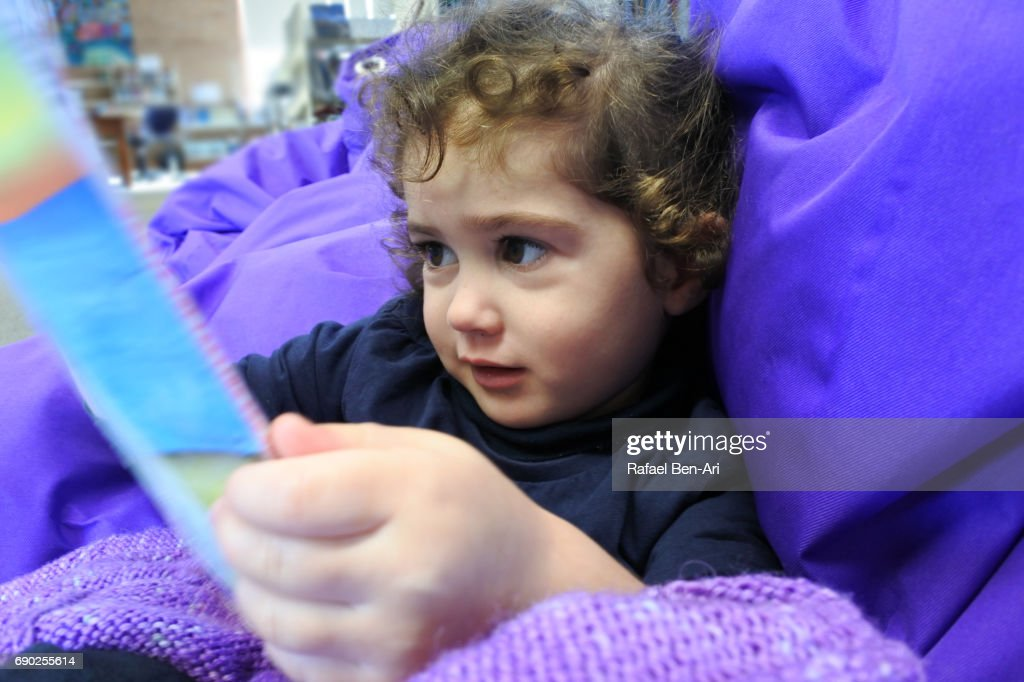 Small girl reads a book : Stock Photo