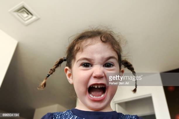 small girl screaming at home - grittywomantrend stock photos and pictures