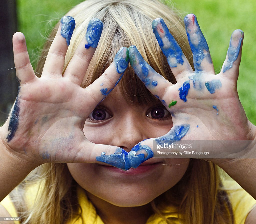Small girl showing finger painting : Stock Photo