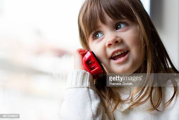 Small girl speaking on the phone