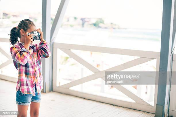 Small girl taking pictures