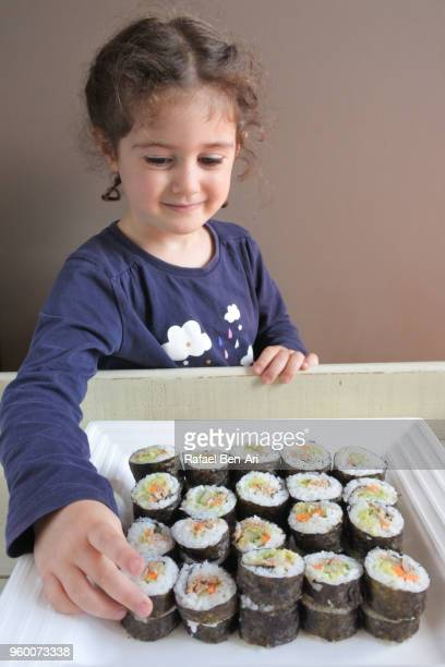Small girl wants to eat Sushi