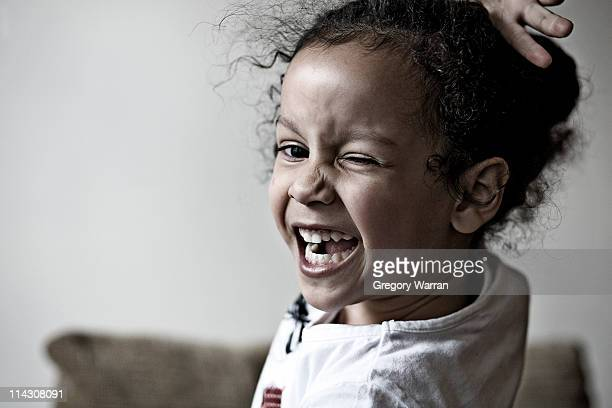 Small girl winking