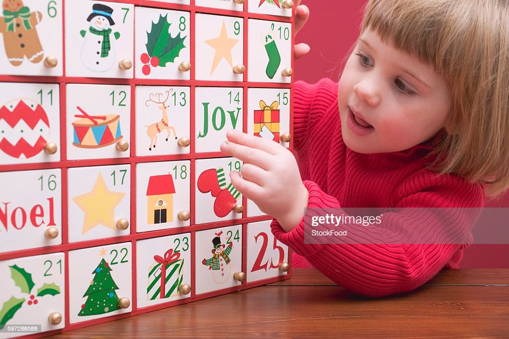 Small girl with Advent calendar : Stock Photo