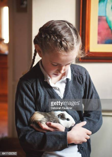 Small girl with guinea pig