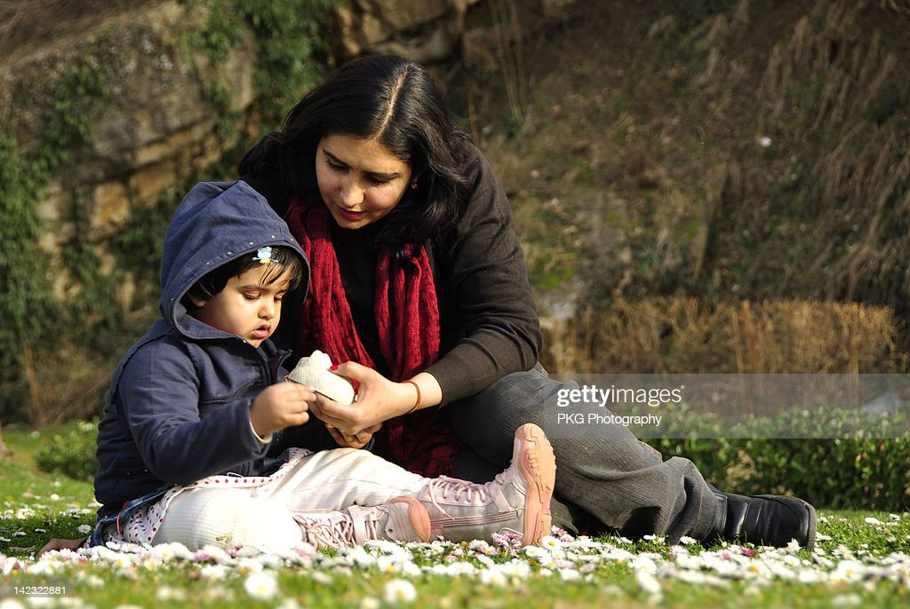 Small girl with mother : Stock Photo