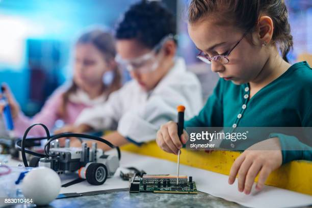 small girl working on motherboard in laboratory. - primary age child stock pictures, royalty-free photos & images