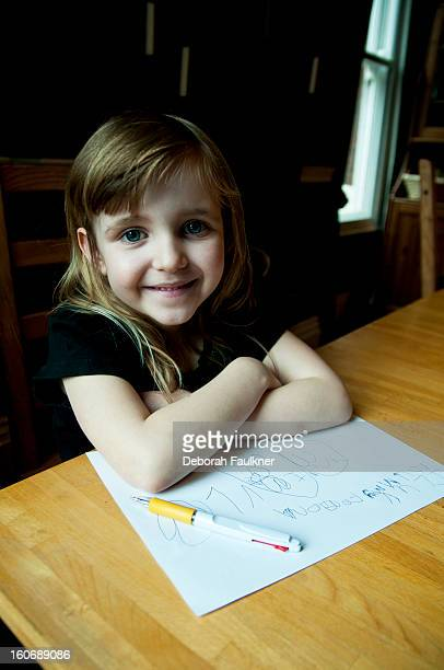 Small girl writing a letter