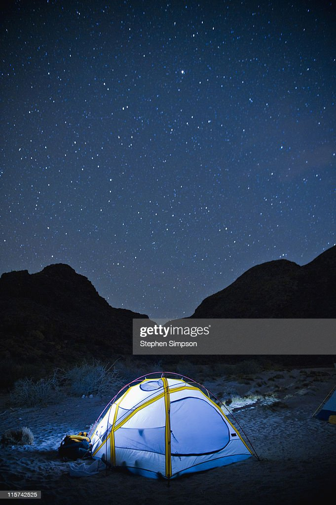 small glowing tent and desert night sky : Stock Photo