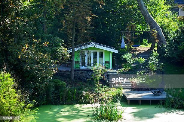 Small green wooden summer house