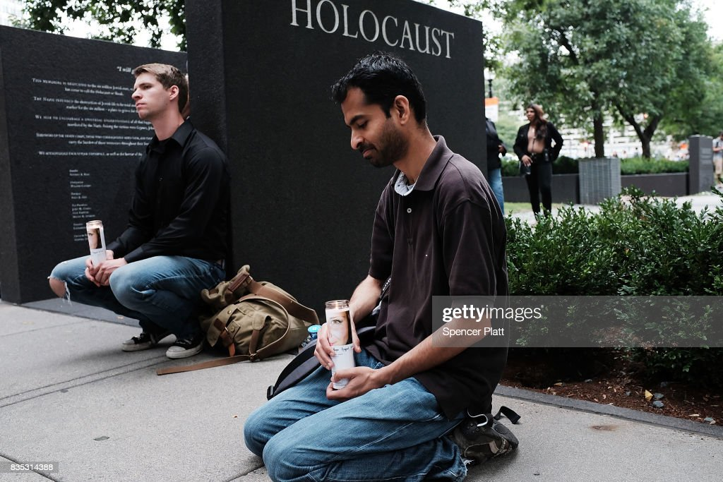 A small group attends a vigil and march at the New England Holocaust Memorial to denounce hate groups before a controversial rally tomorrow on August 18, 2017 in Boston, Massachusetts. A free speech rally planned on Saturday on Boston Common has sparked fears of possible violence only a week after racially charged protests in Charlottesville, Virginia, turned deadly. Thousands of counter protesters are expected to attend the event which police vow to keep peaceful.