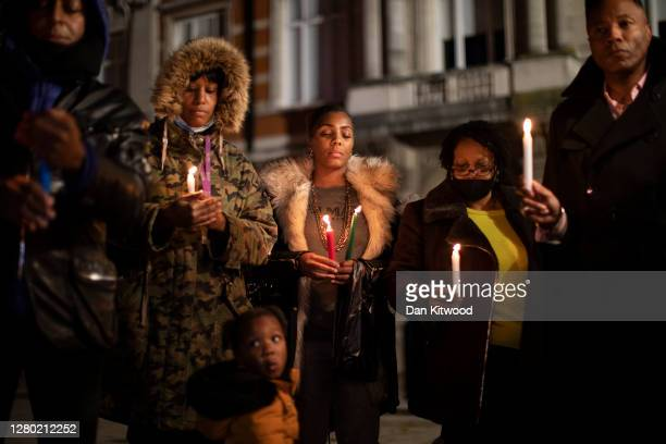 Small group hold a candlelit vigil to mark what would have been the birthday of George Floyd, in Windrush Square in Brixton on October 14, 2020 in...