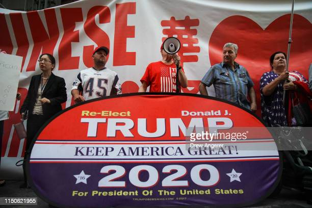 A small group of activists rally in support of US President Donald Trump across the street from Trump Tower on 5th Avenue June 18 2019 in New York...