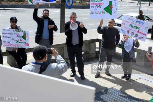 Small group of Algerian immigrants gathers to protest in center City Philadelphia PA on March 24 2019 The group rallies in support of tens of...
