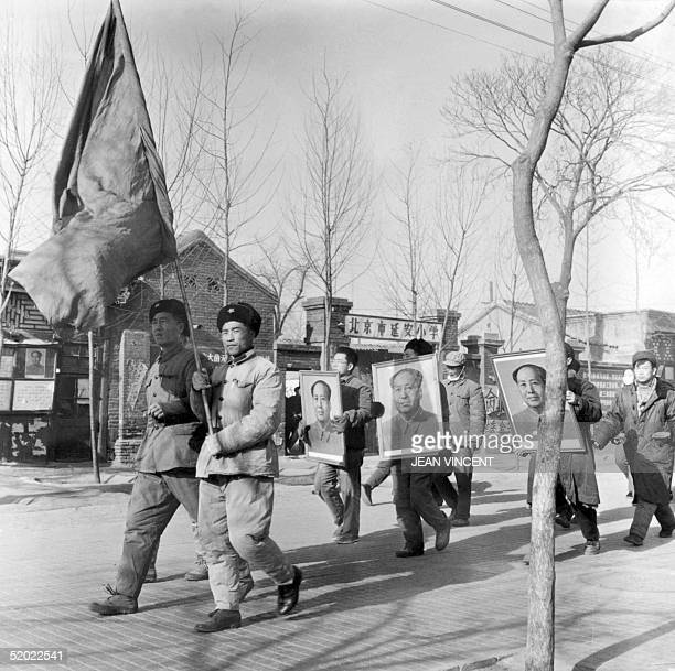 A small group of Chinese Red Guards shout slogans while parading with portraits of Mao Zedong Chinese communist party leader and President of the...