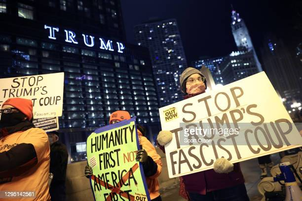 Small group of demonstrators protest near Trump Tower on January 07, 2021 in Chicago, Illinois. They called for the removal of President Donald Trump...
