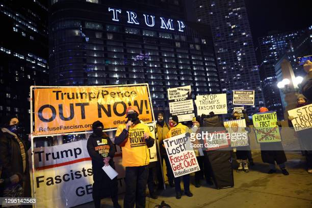Small group of demonstrators protests near Trump Tower on January 07, 2021 in Chicago, Illinois. They called for the removal of President Donald...