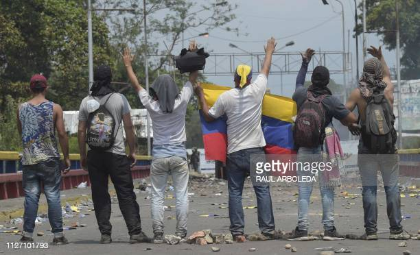 A small group of demonstrators wait after provoking members of the Venezuelan Bolivarian National Guard on the Francisco de Paula Santander...