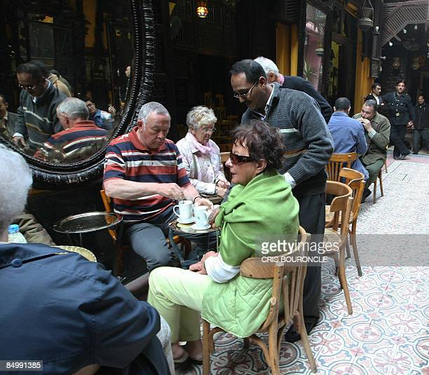 A small group of German tourists visit the popular ElFishawi coffee shop in the tourist bazaar close to the AlHussein mosque in Cairo on February 23...