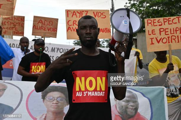 A small group of Ivory Coast's political opposition suporters protest against a third term of President Alassane Ouattara's in street of Anono...