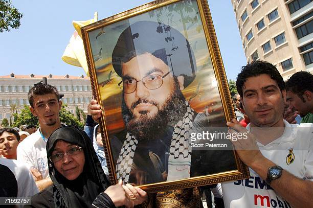 Small group of Lebanese hold a portrait of Hezbollah leader Hassan Nasrallah during an anti-U.S./pro-Hezbollah rally provoked by the visiting U.S....