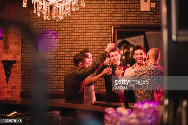 small group of men having a drink - nightlife stock pictures, royalty-free photos & images