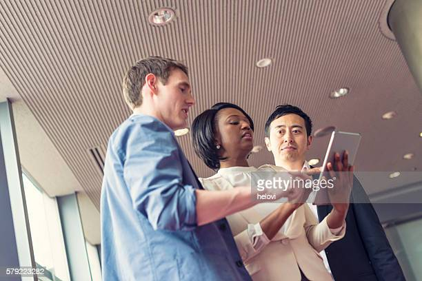 Small group of multi-ethnic business people in conversation