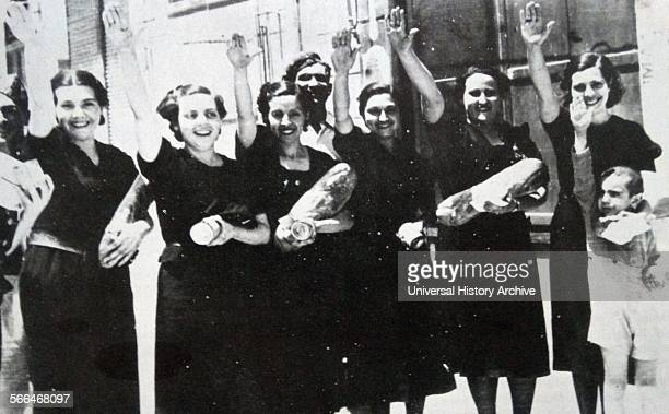 A small group of nationalist war widows making a fascist salute as their town is taken by Francoist forces during the Spanish Civil War