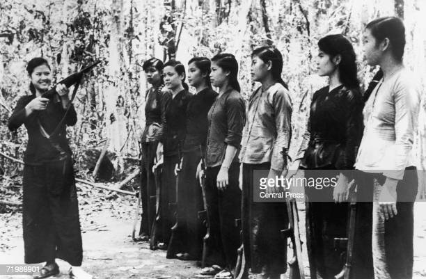 A small group of North Vietnamese women undergoing rifle training before joining Viet Cong forces during the Vietnam War 11th September 1967 Their...