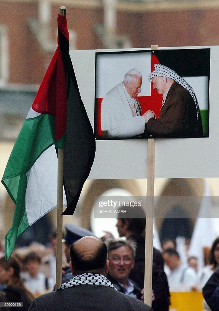 A small group of Palestinians living in Krakow came to express their sorrow as they joined white march on the eve of John Paul II's funeral in Krakow, 07 April 2005 .From the president of the country on down, just about everybody in Poland who has offered a historical assessment of the late Pope John Paul II says more or less the same thing ' Without him a free Poland would not exist today '.