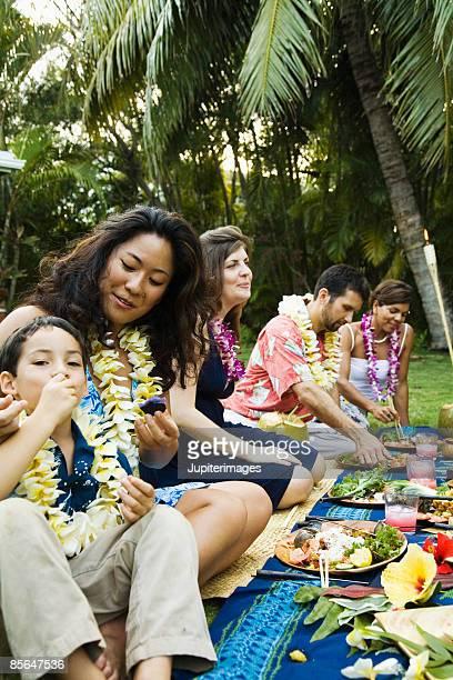 Small group of people at Hawaiian picnic