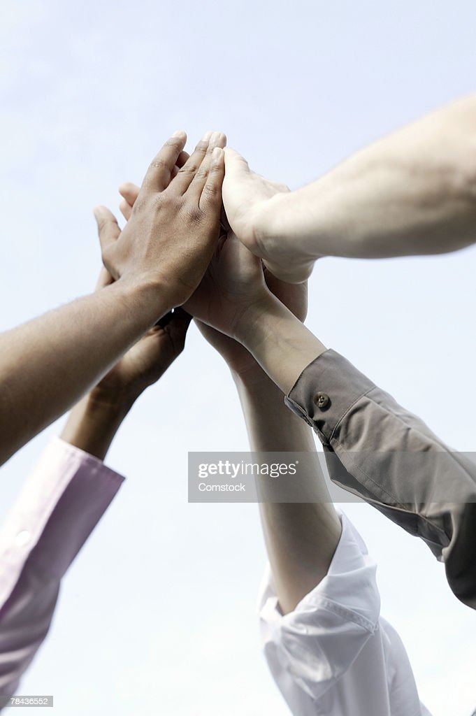 Small group of people giving high-five : Stockfoto