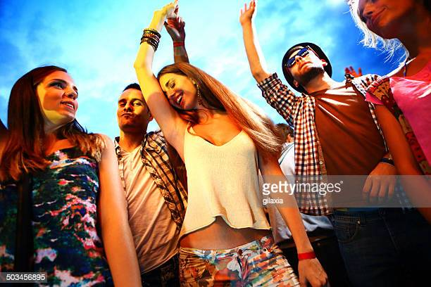 small group of people having fun at concert. - brightly lit stock pictures, royalty-free photos & images