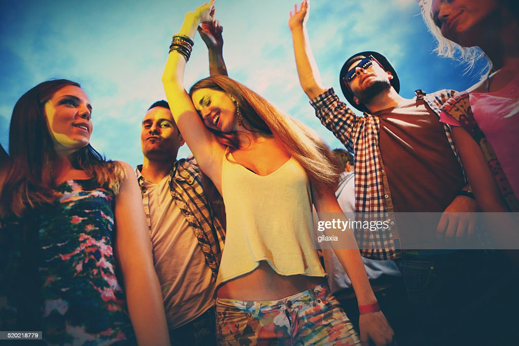Small group of people having fun at concert. : Stock Photo