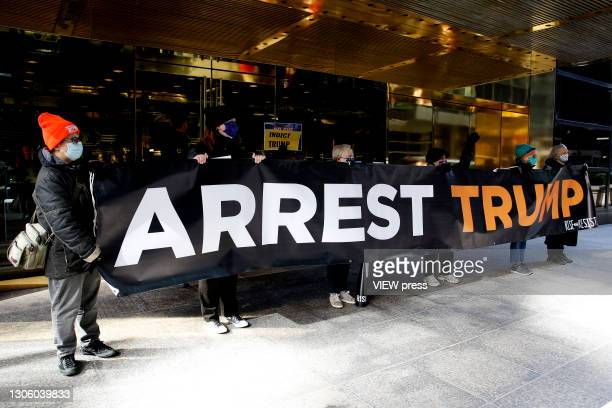 Small group of people hold a placard during a protest against the former U.S. President Donald Trump at Trump Tower on March 08, 2021 in New York....