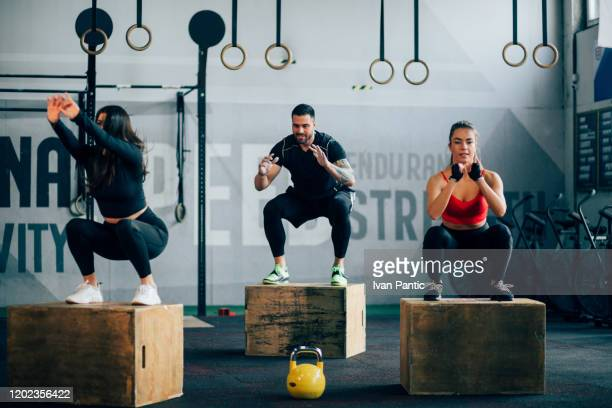 small group of people working out in a gym - cross training stock pictures, royalty-free photos & images