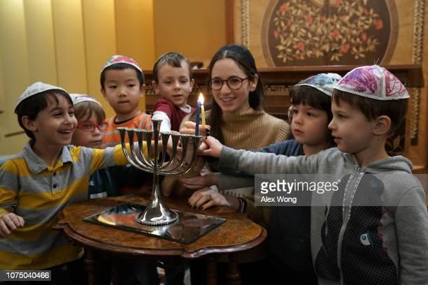 A small group of preschoolers from Gan HaYeled learn how to light a Hanukkah menorah from Rabbi Sarah Krinsky at Adas Israel Congregation November 30...