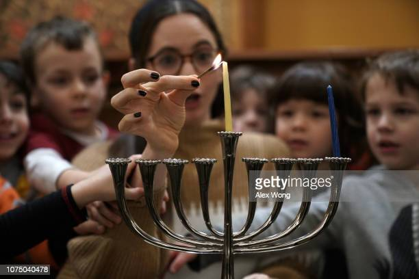 A small group of preschoolers from Gan HaYeled learn how to light a Hanukkah menorah from Rabbi Sarah Krinsky at Adas Israel Congregation November 30...