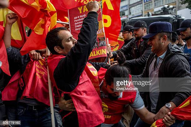 Small group of protesters clash with police on a street in the Besiktas neighbourhood during a May Day demonstration on May 1, 2016 in Istanbul,...