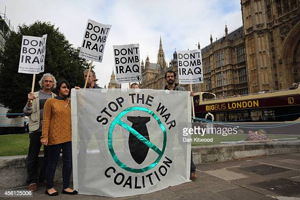 Small group of protesters gather on Abingdon Green outside The Houses of Parliament on September 26, 2014 in London, England. MPs will vote later...