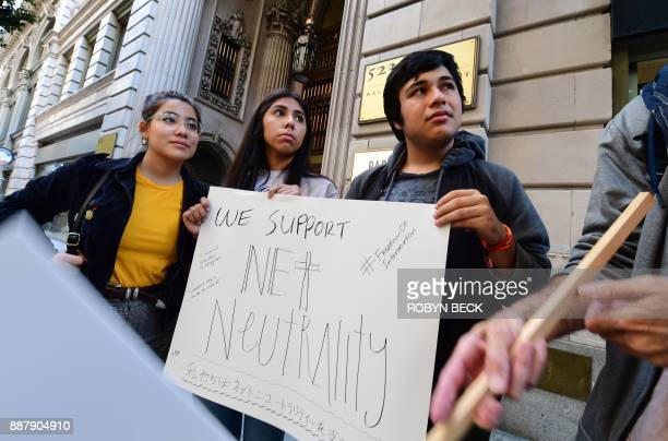A small group of protestors supporting net neutrality protest against a plan by Federal Communications Commission head Ajit Pai during a protest...