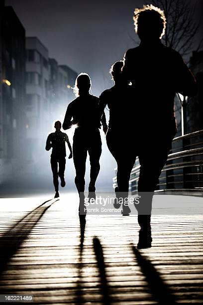 small group of runners by night